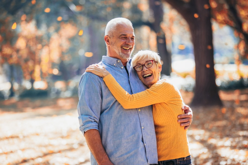 older couple smiling and laughing outside