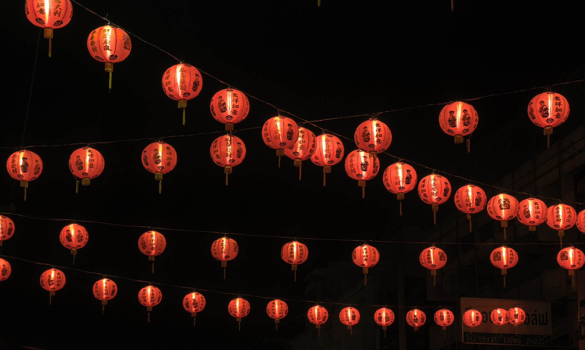 orange sky lanterns on a black background to show how colour can be strong in branding