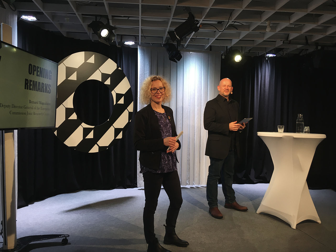 A woman and a man presenting on stage at 2nd European Social Progress Cities Summit