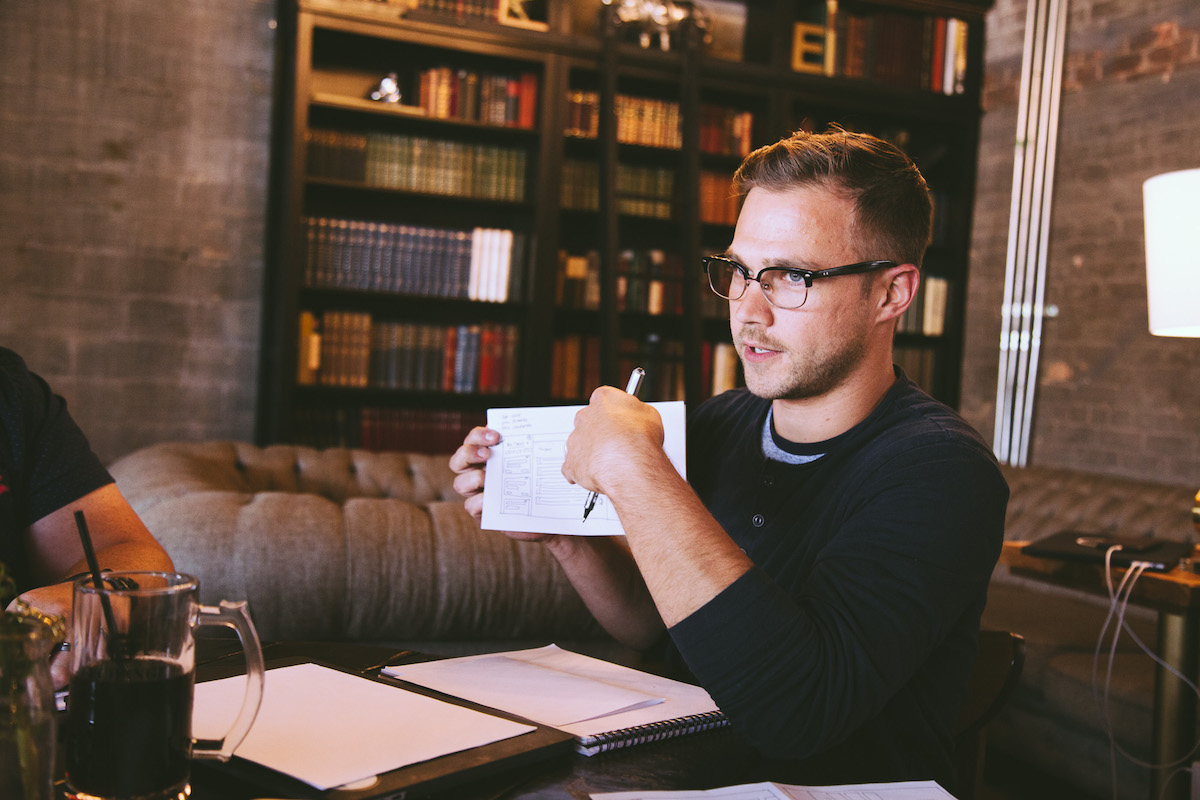 man talking in meeting at coffee shop