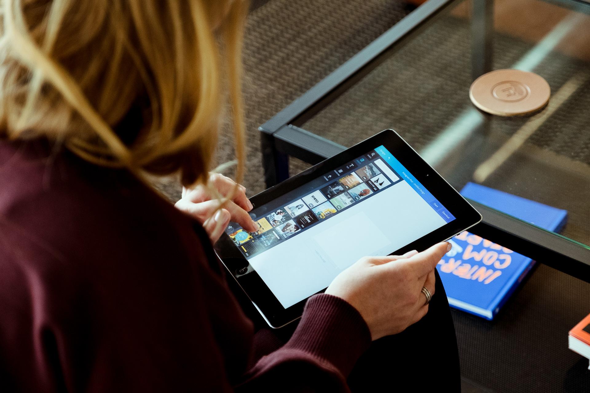 woman using ipad app
