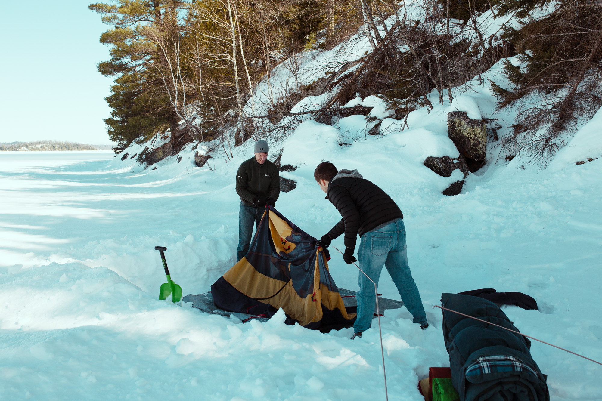 Setting up tent on frozen lake