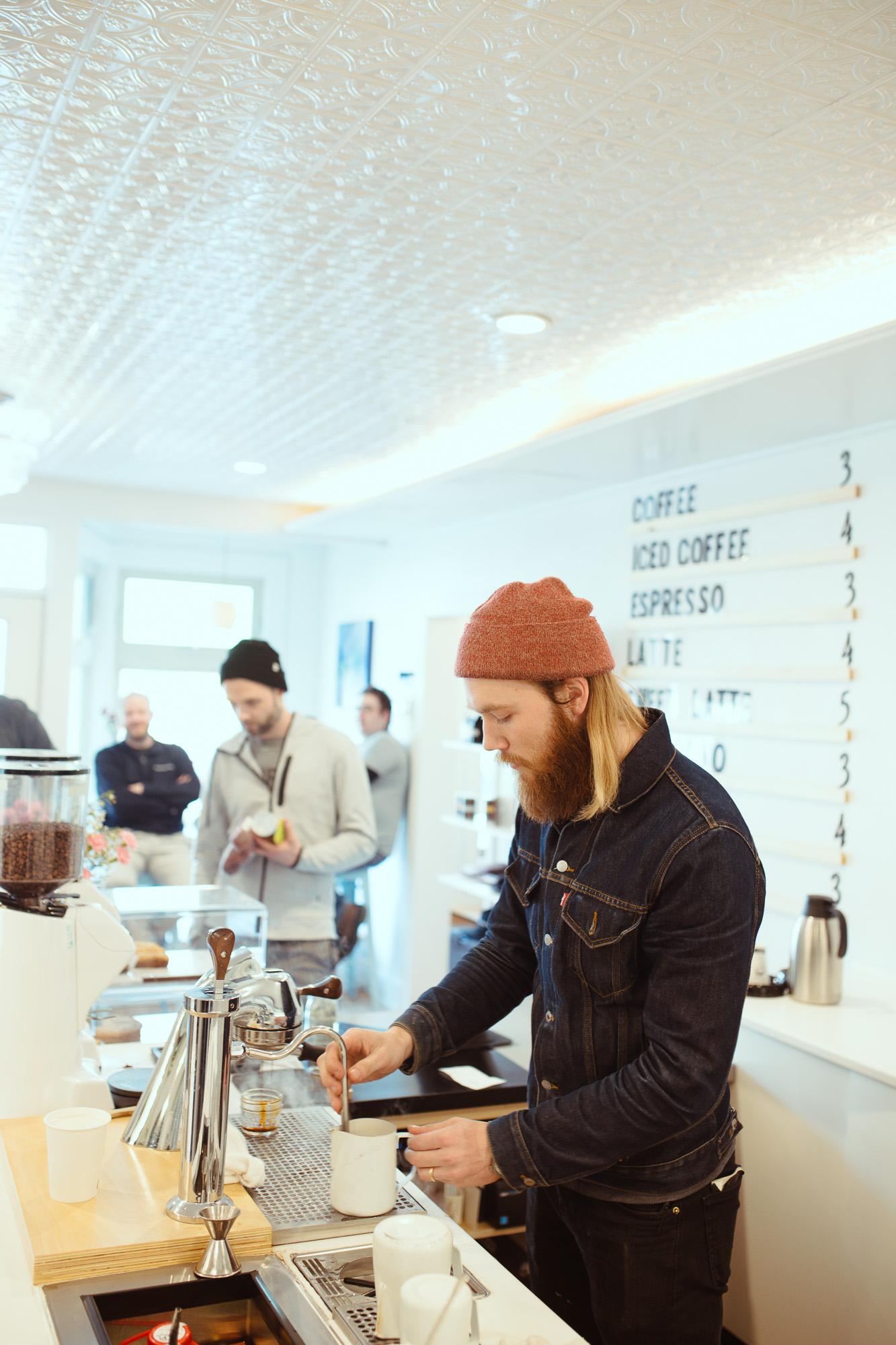 Man behind coffee bar