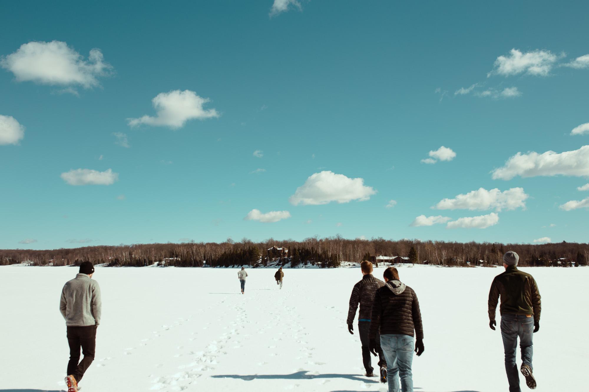 Group walking across frozen lake
