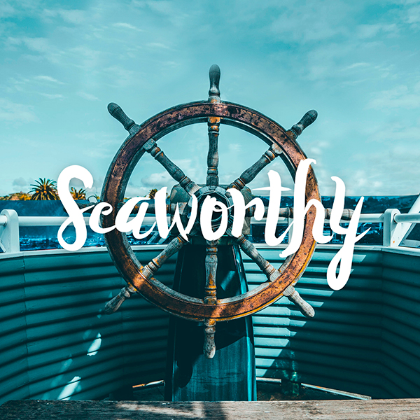 seaworthy logo in front of ship helm
