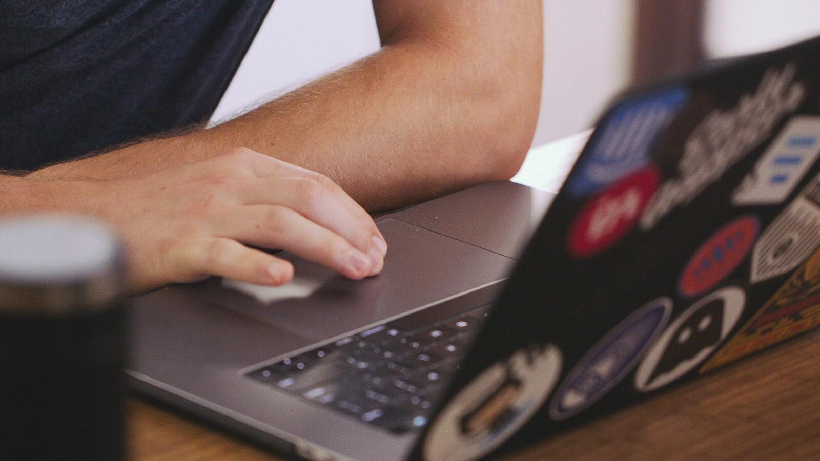 hands typing on macbook pro