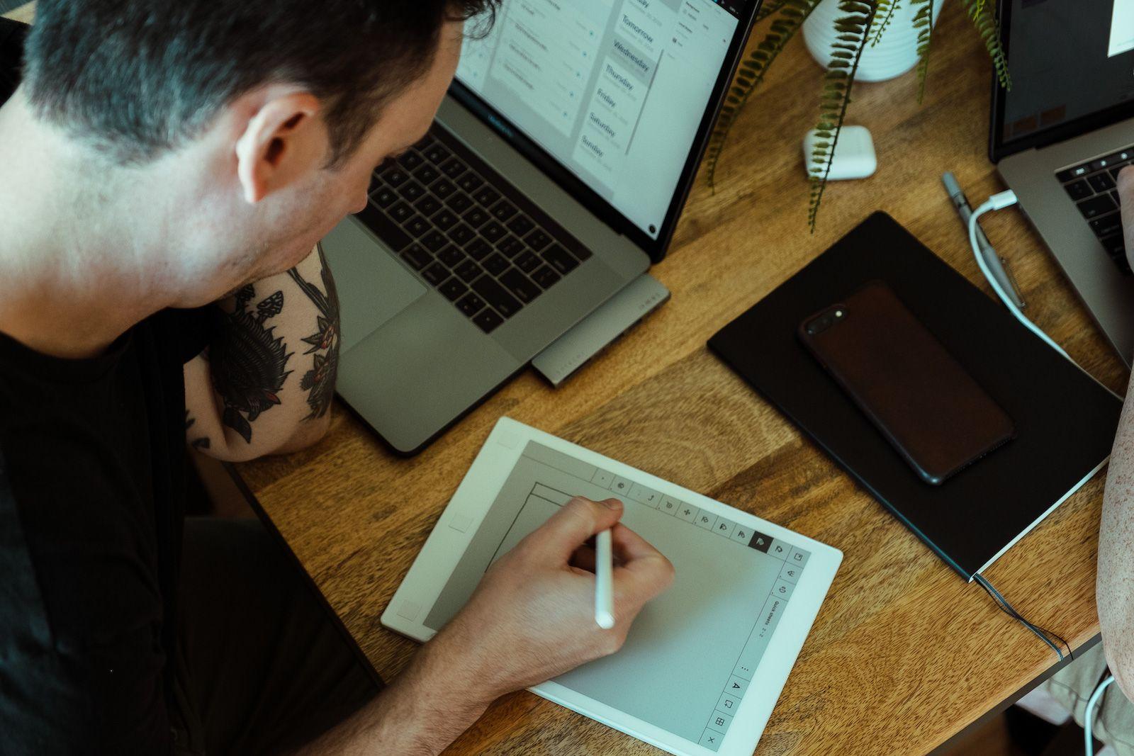 designer using tablet to sketch ideas