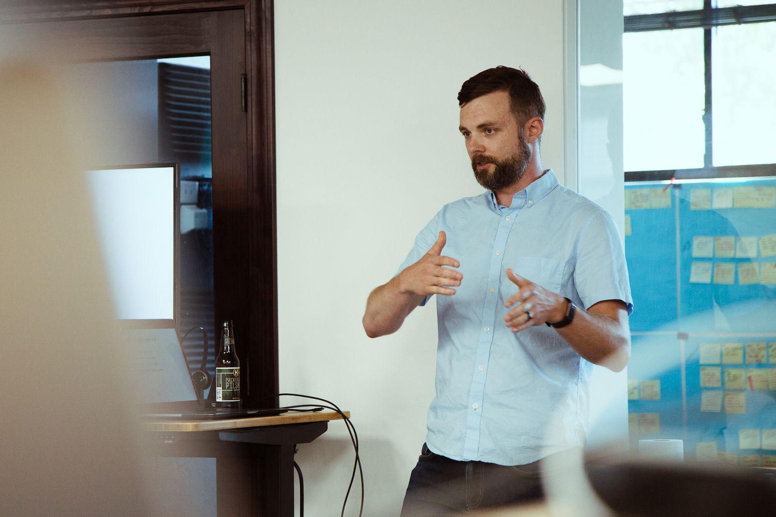 young man presenting at meetup