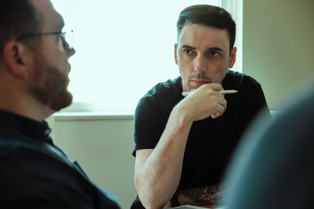 person intentionally listening in a meeting