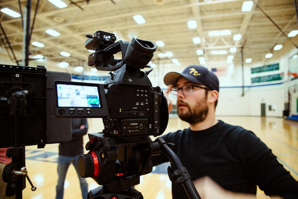 man behind video camera