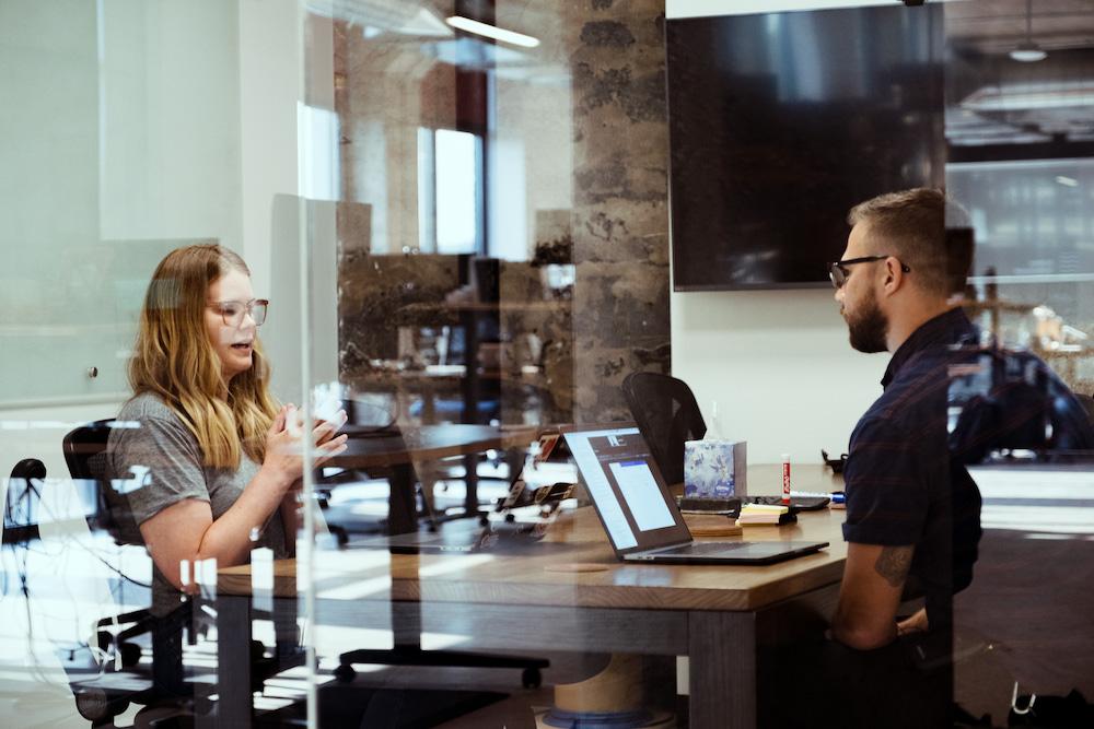 designer interviewing customer about new software idea
