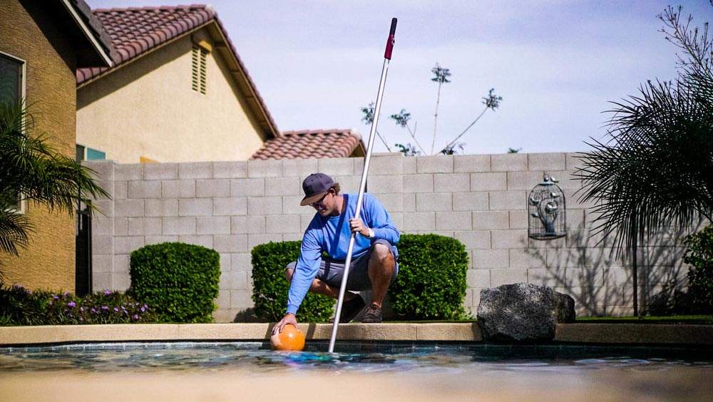 Daniel Brennan, cleaning pool in AZ