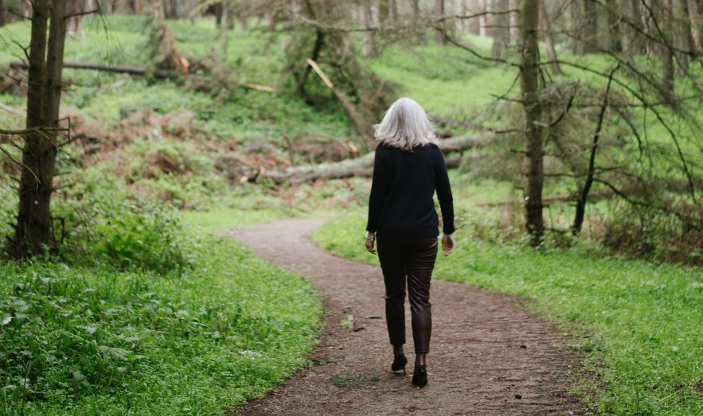 Anna Scott walking through the woods