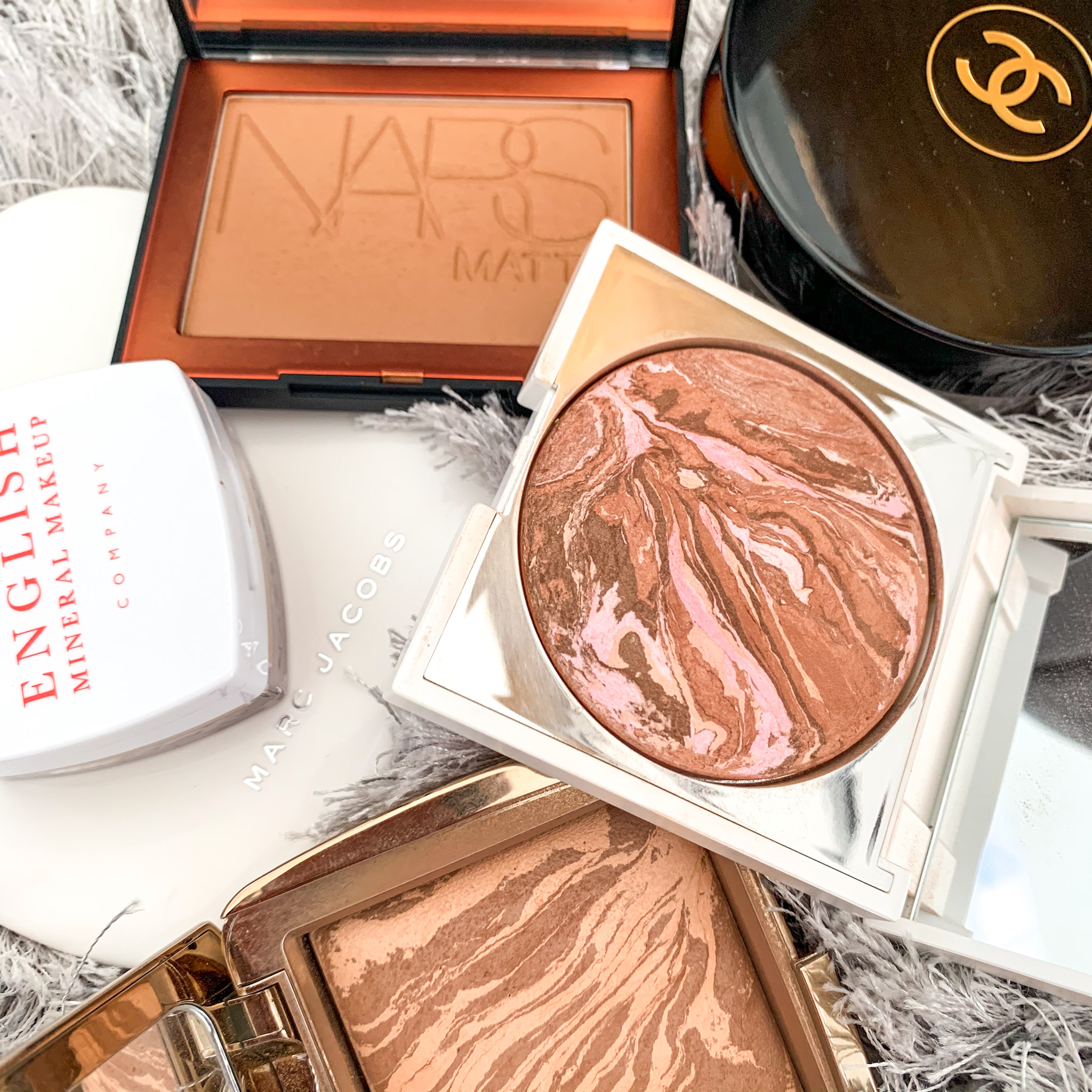 A lineup of bronzers used and recommended by me.