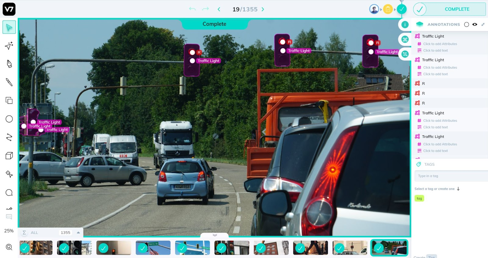 A street with cars and annotated traffic lights for traffic light detection in self driving cars.