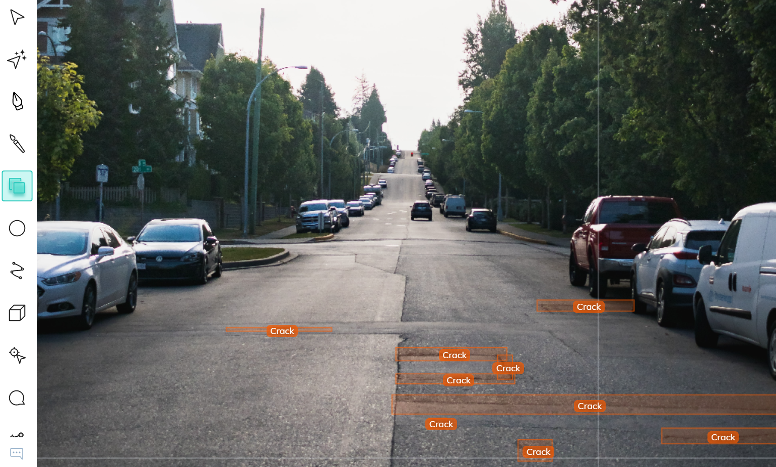 Bounding boxes around cracks in the road for AI road condition monitoring