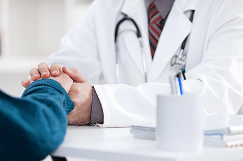 Caring physician discusses options with patient