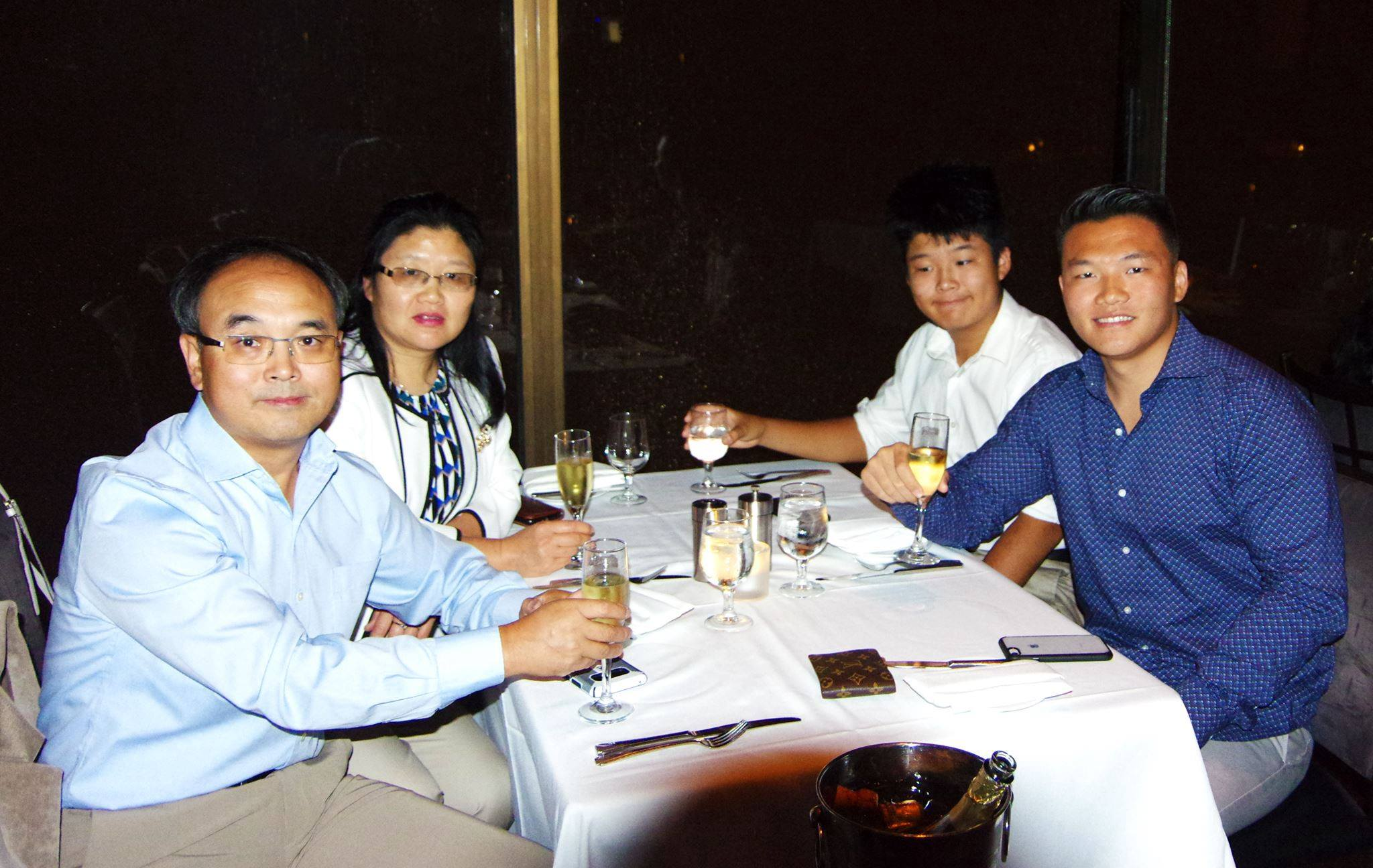 Kevin Zhang with family at dinner