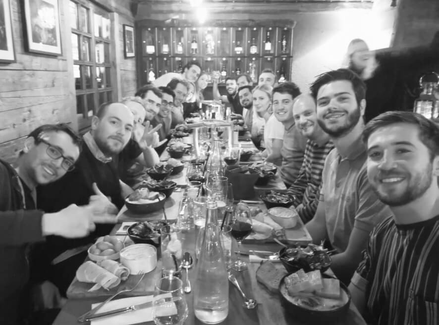 The Birdie team have dinner on a long table
