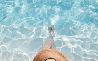 Woman relaxing inside pool