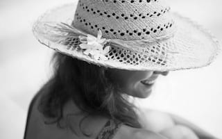 woman wearing a hat while relaxing
