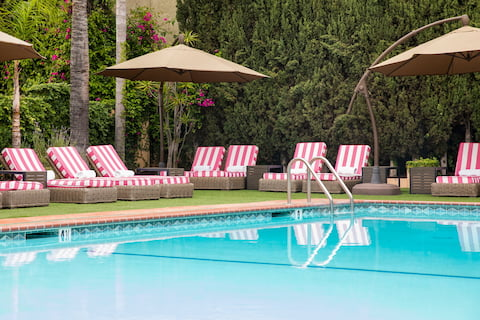 Hollywood Hotel Swimming Pool with RH Chaise Lounge and ADA Chair Lift