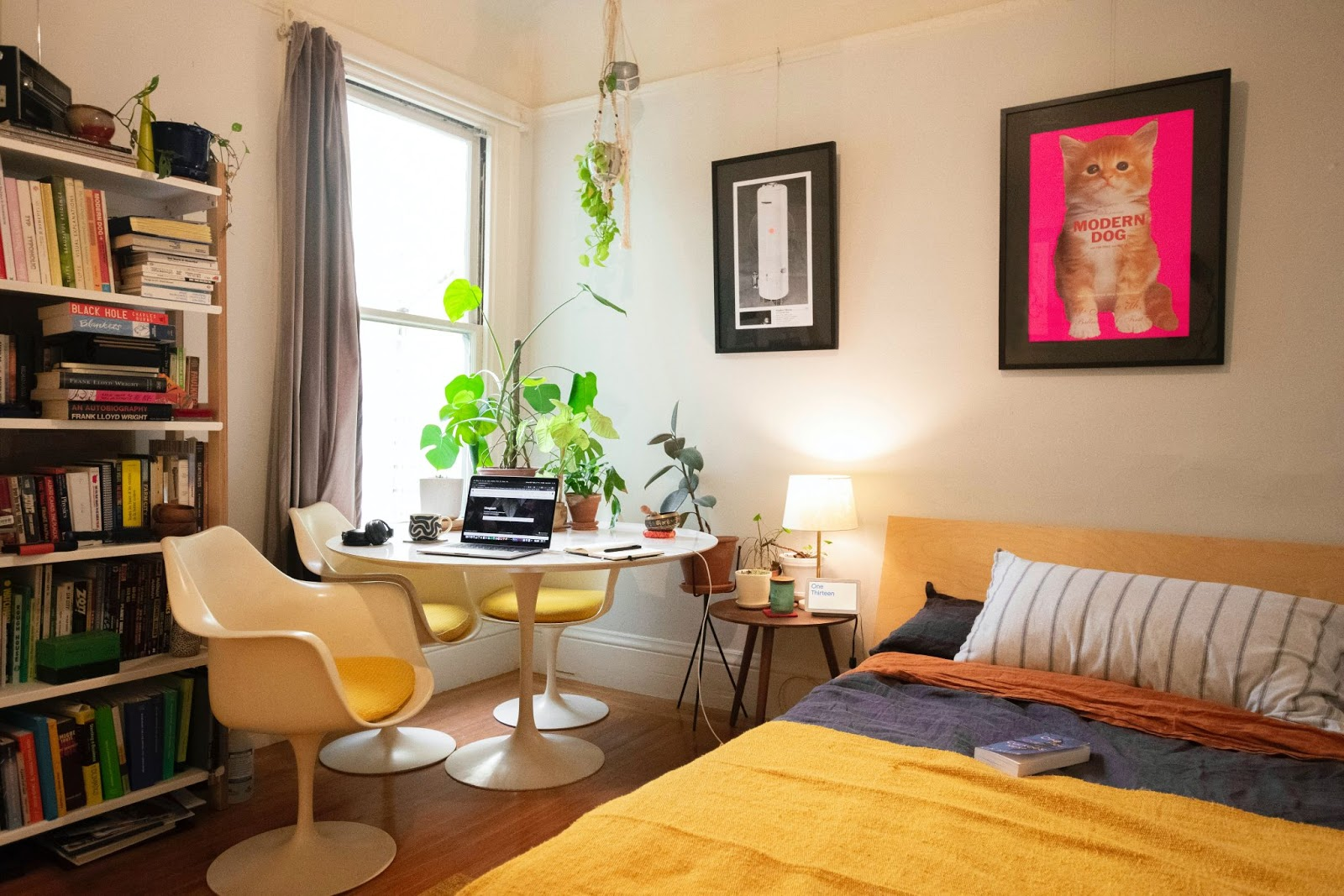 laptop in corner of room with yellow bed home office design