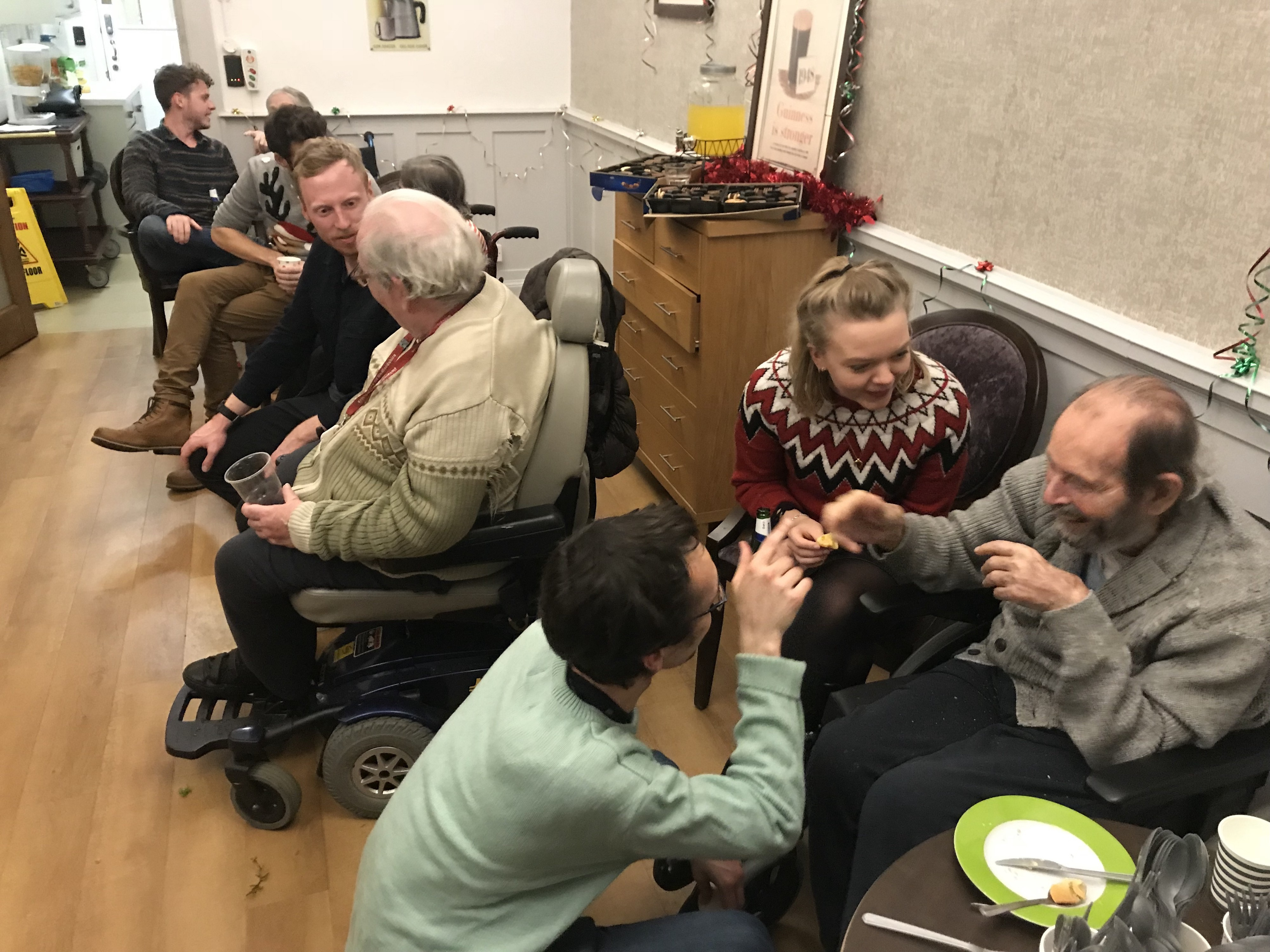 the birdie team volunteering in a care home to help older adults