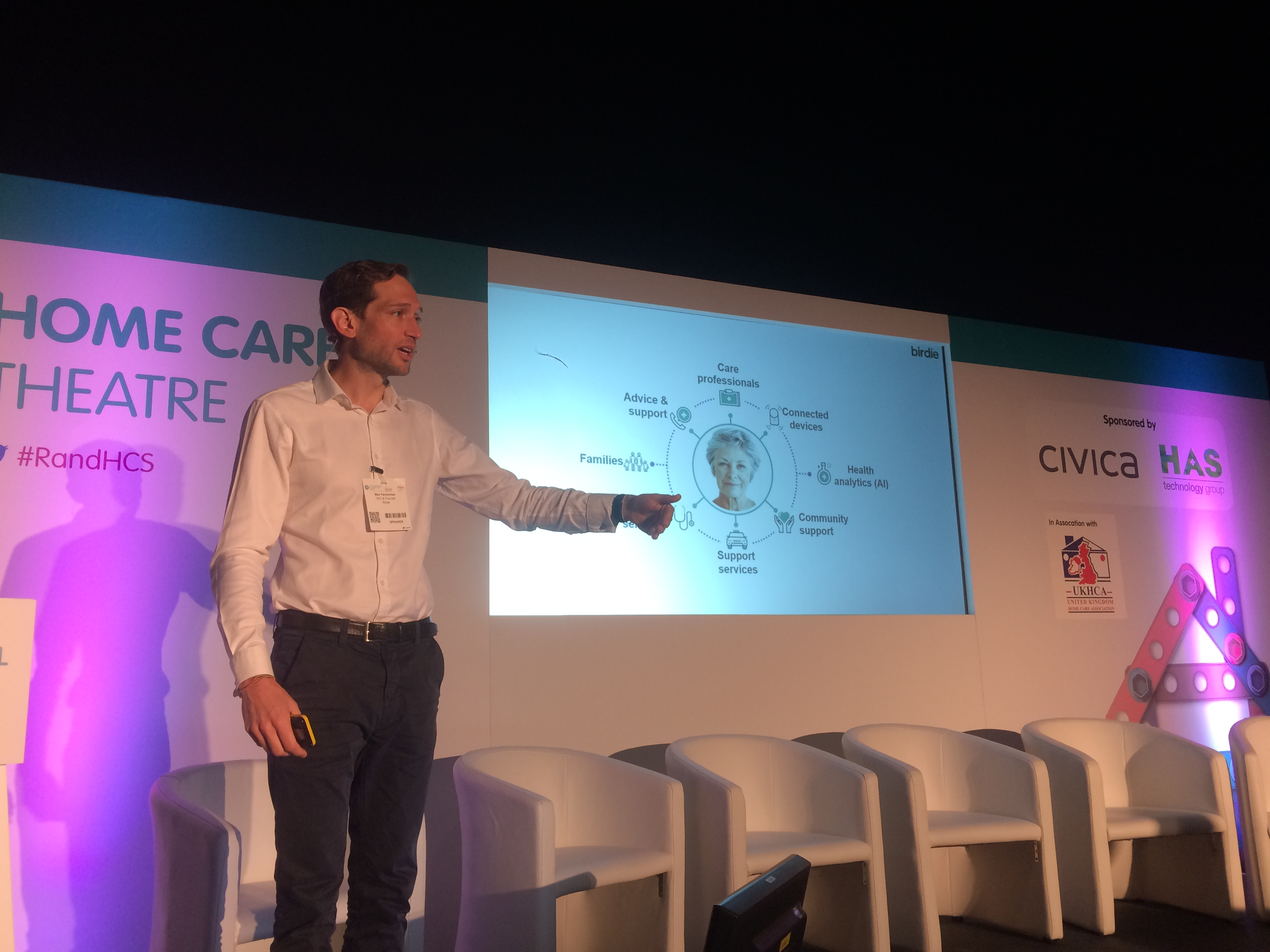 Birdie CEO Max delivering a presentation at Health Plus Care event