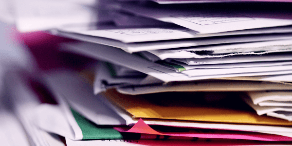 stacks of paper care plans on a desk