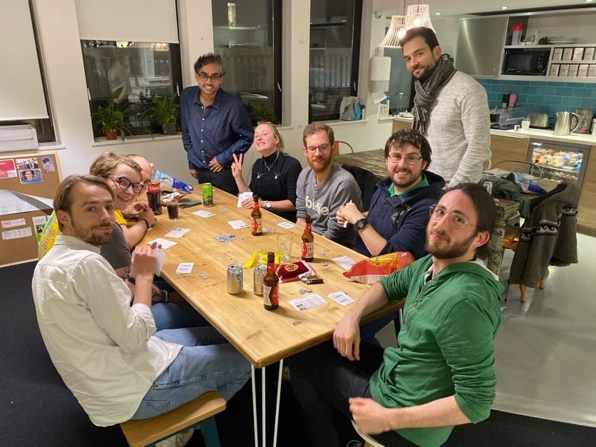 A group of co workers playing board games at the office