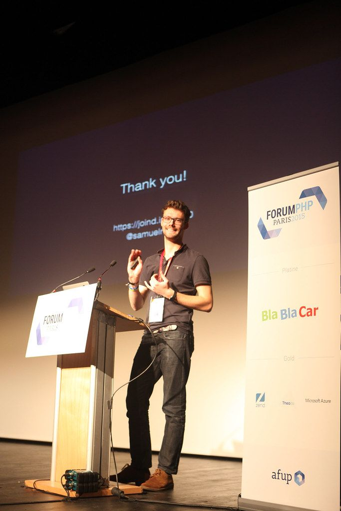 a man presenting at a tech conference