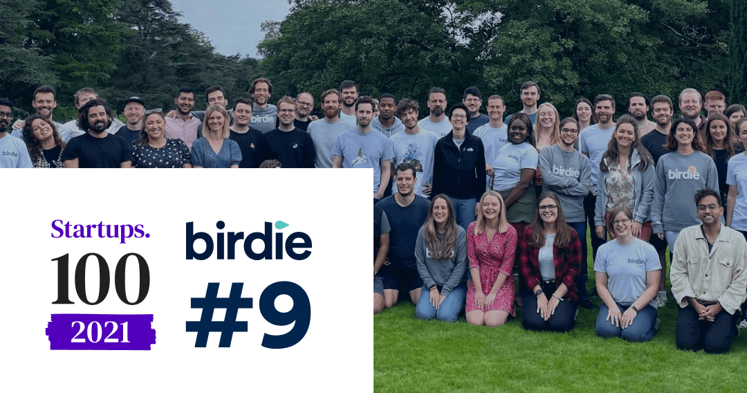 Team photoshoot where areound 60 people are standing outside in the sunshine. Text reads, Startups100 2021, Birdie #9