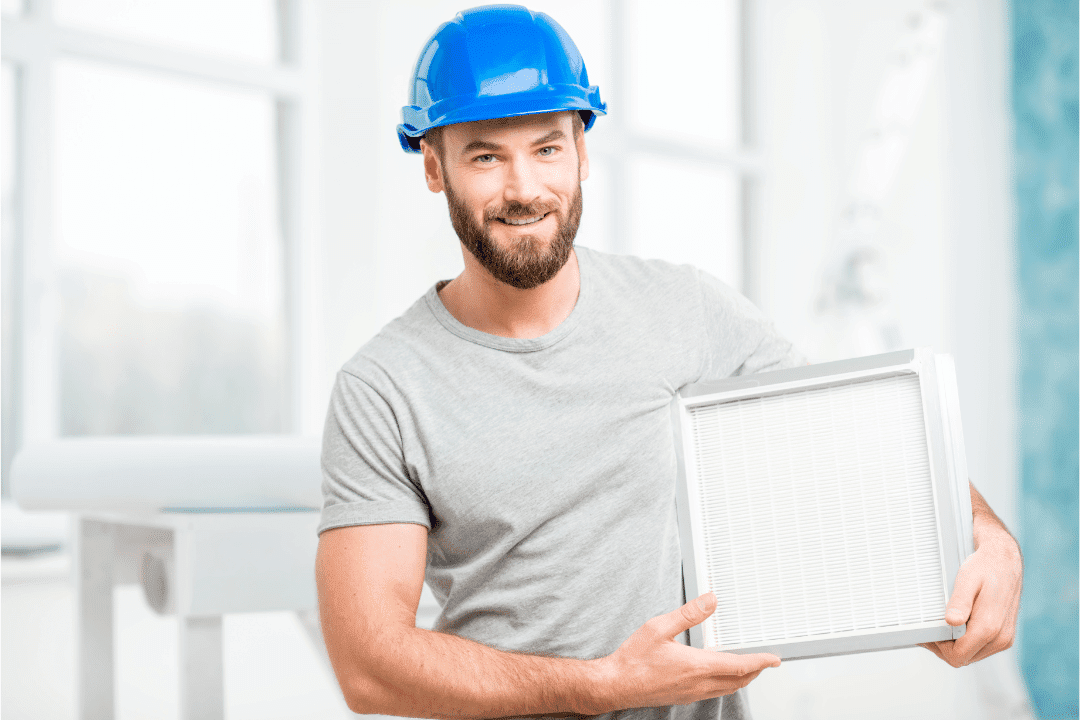 man blue hard hat holding air filter beard white background square filter