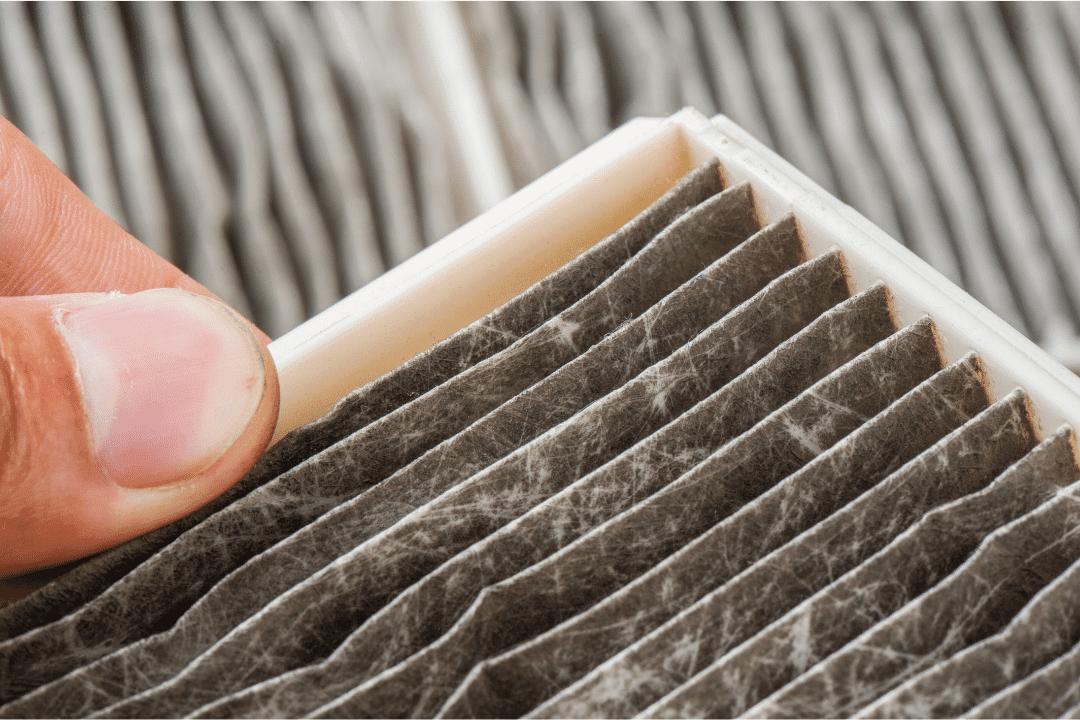 dirty air filter close up thumb change hvac dirt dust pollen