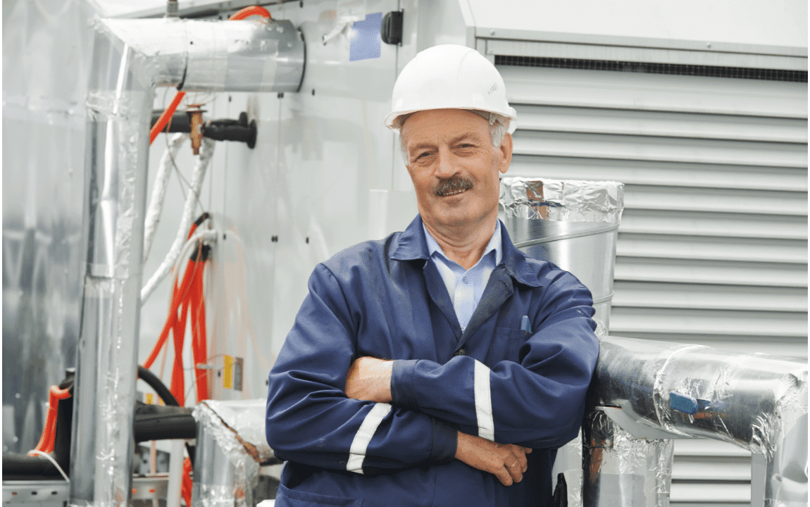 contractor standing arms crossed in front of air ducts