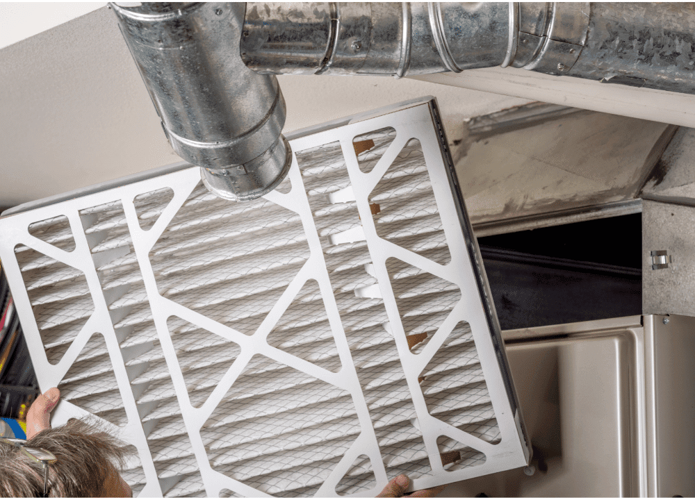air filter in HVAC system getting inspected and replaced