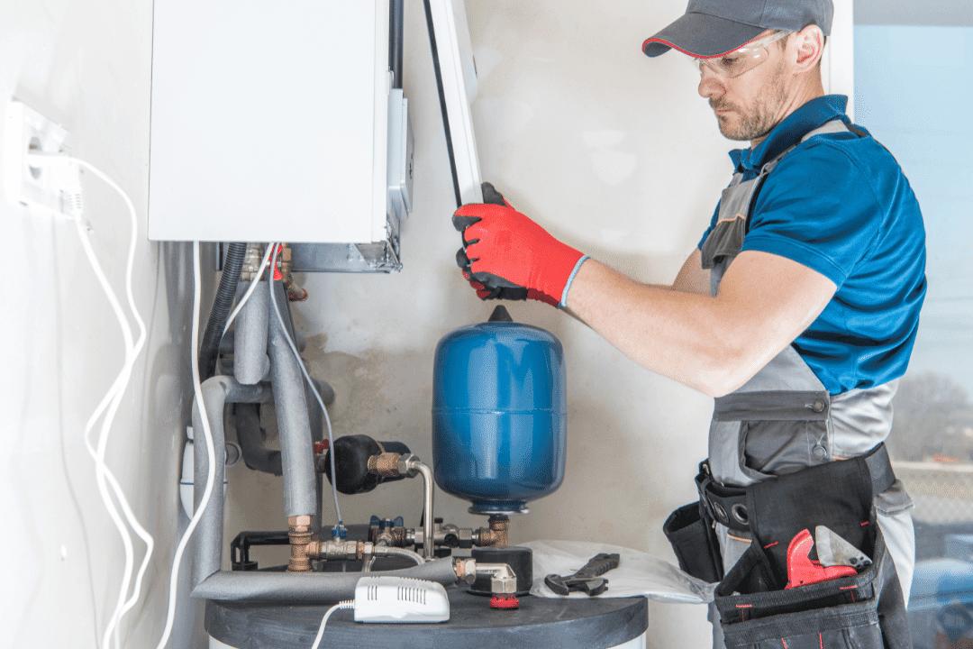 repairman fixing home furnace replacing cover