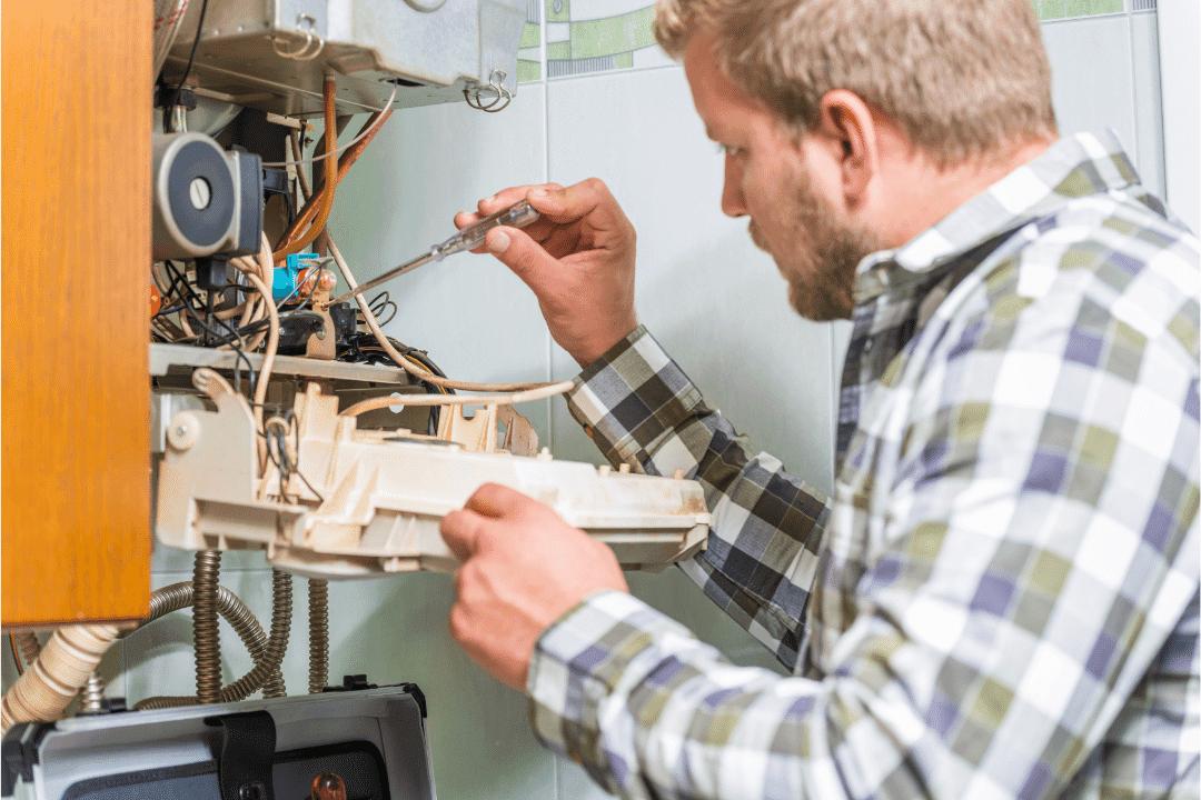 hvac repairman fixing gas furnace