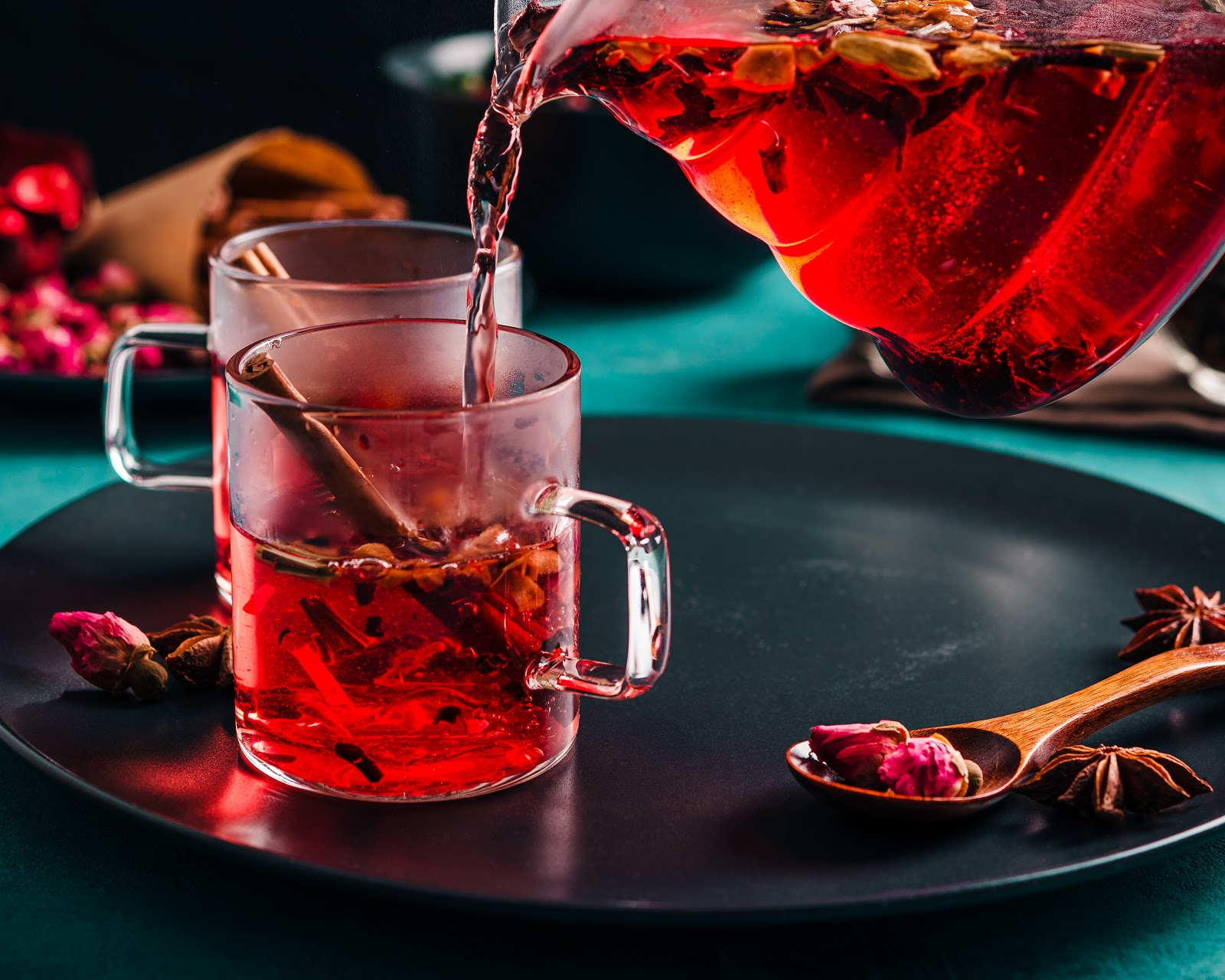 pouring rose hip tea into cup