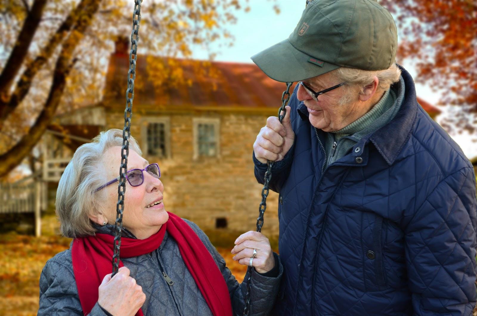 elderly couple on swing