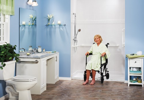 elderly woman in wheelchair by accessible shower