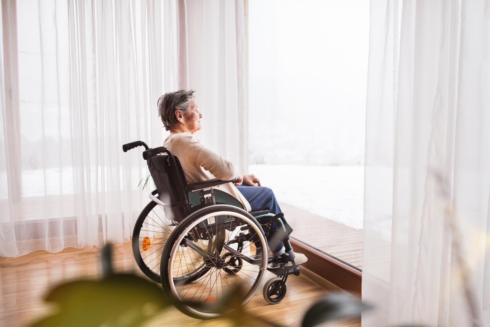 elderly woman sitting in a wheelchair