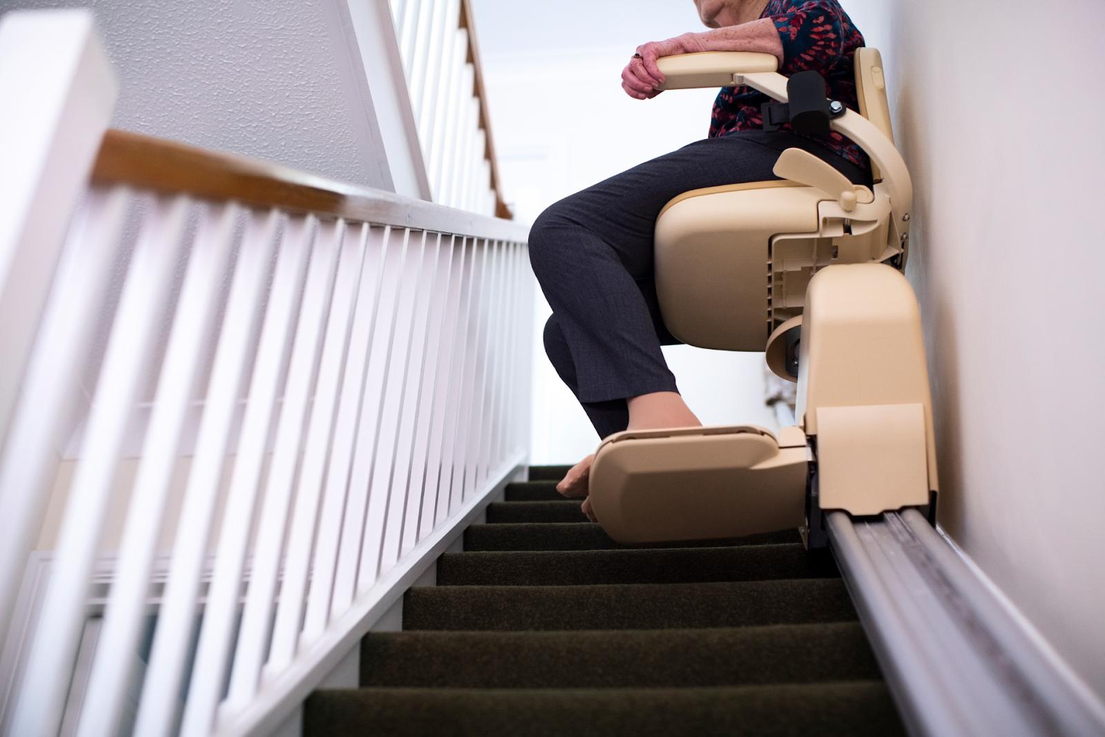 elderly woman using stairlift