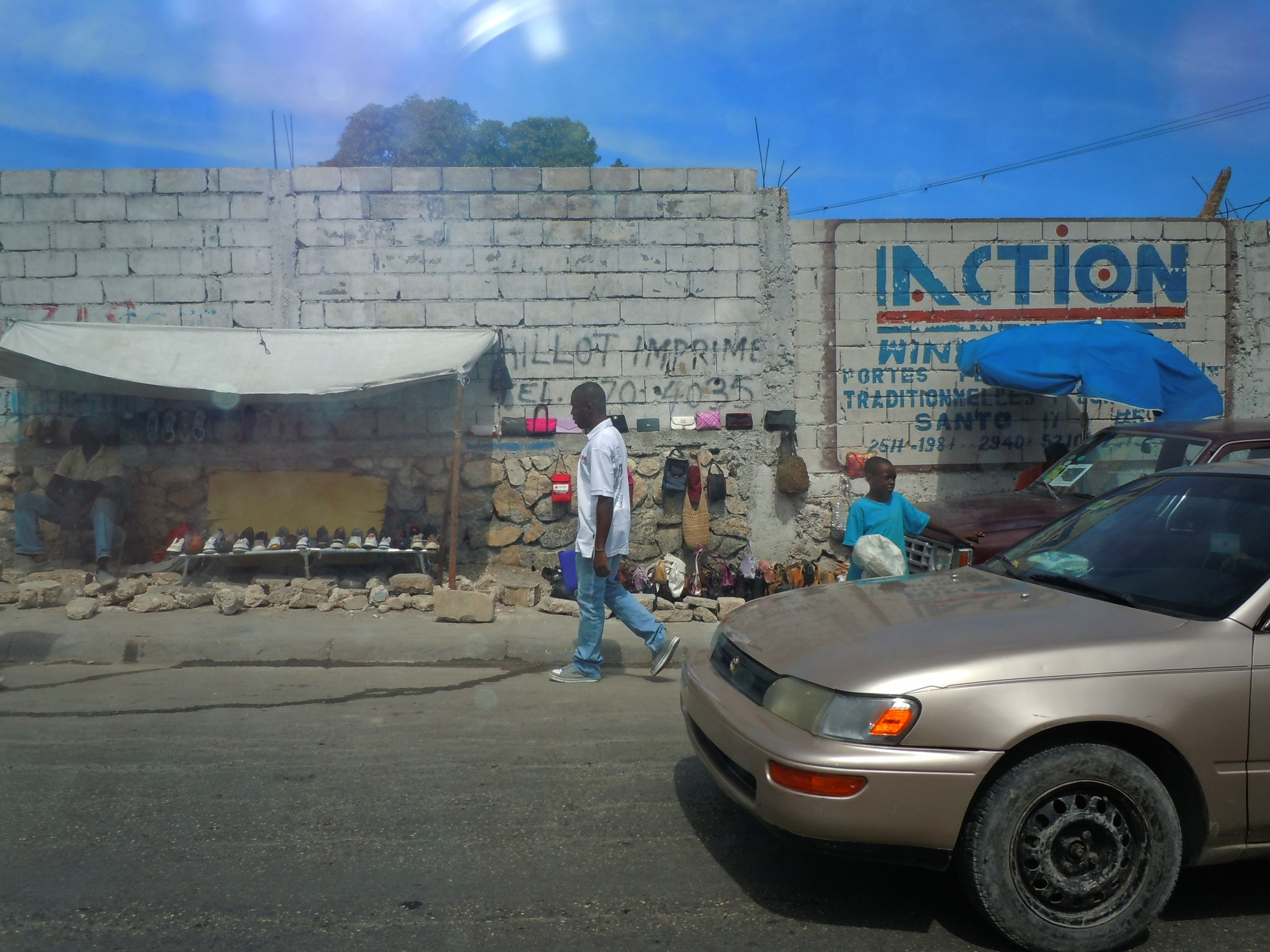A local man walking in the street in Haiti - The Adventure Project