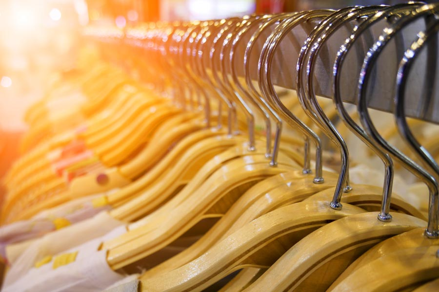 Photograph of hangers in a retail environment.