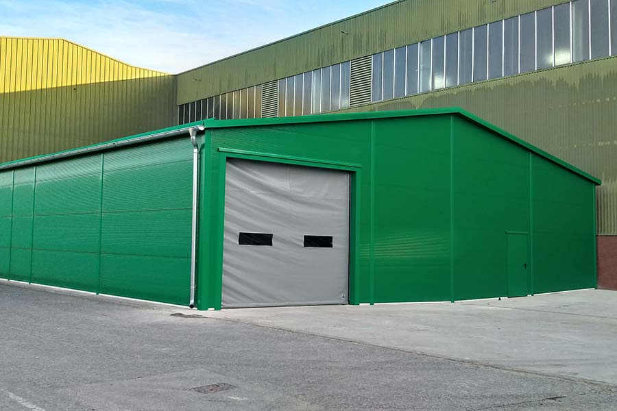 Photograph of a green temporary warehouse built by Big Box Buildings