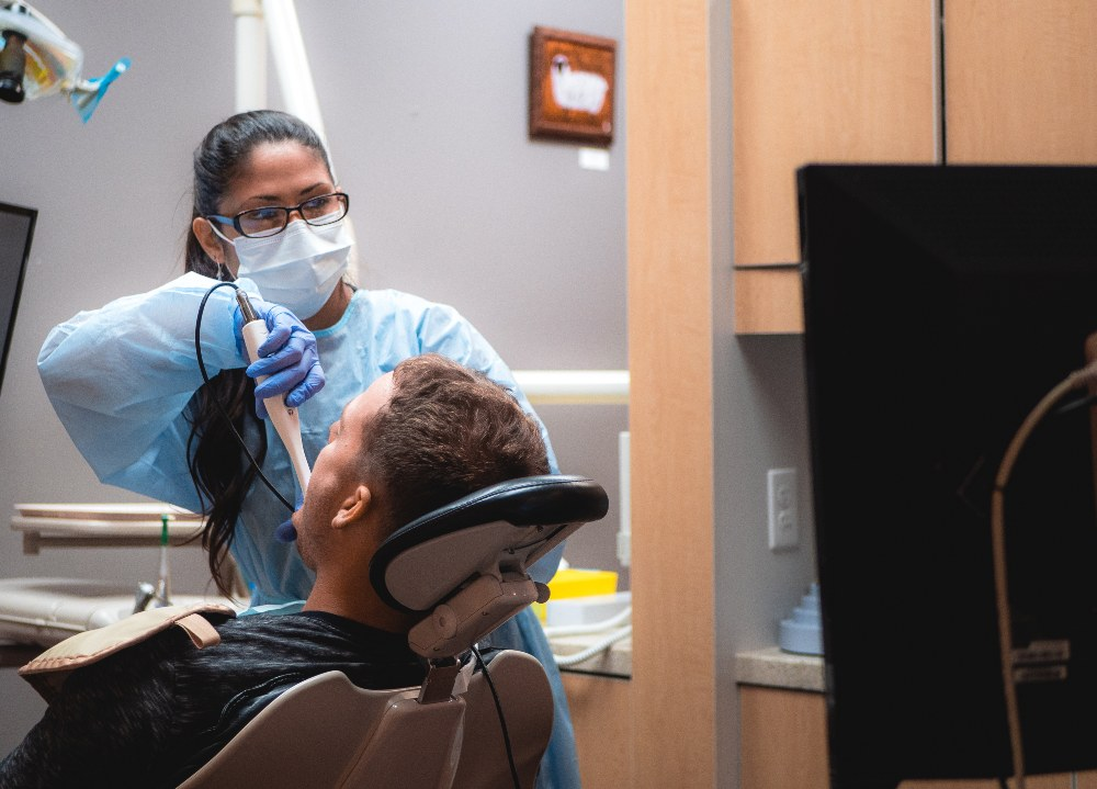al hygienist working on a patient