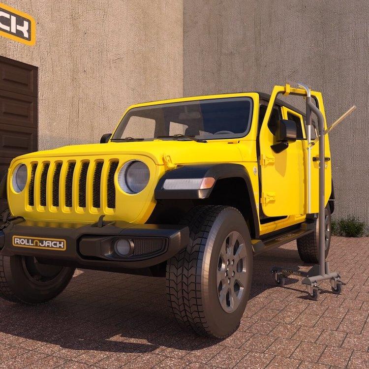 Door on the RollnJack door lift next to a Jeep
