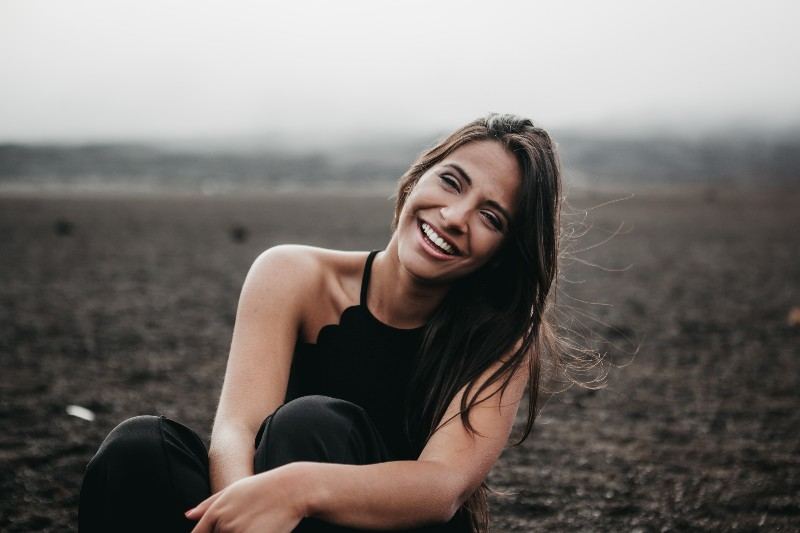 woman sitting outside smiling